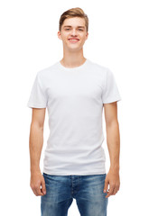 smiling young man in blank white t-shirt