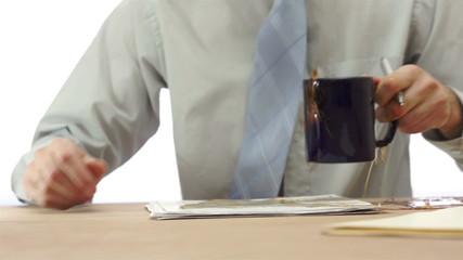 Male Office Worker Spills Coffee
