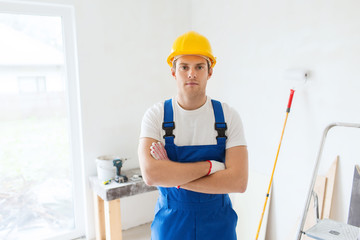 builder in hardhat with working tools indoors