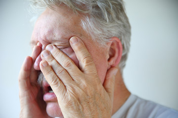 Cold or flu symptoms in a senior man