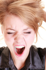 Angry furious woman screaming and pulling messy hair