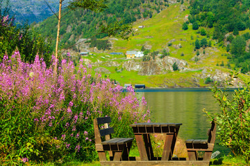 Picnic table and benches near lake in Norway, Europe.