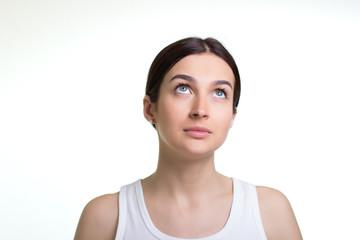 Beautiful young woman daydreaming