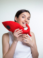 a woman with a red toy fish