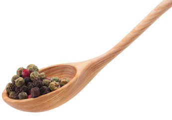 Pepper seasoning  mix in wooden spoon isolated on white backgrou