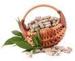 Herbal drug capsules in wicker basket. Alternative medicine conc