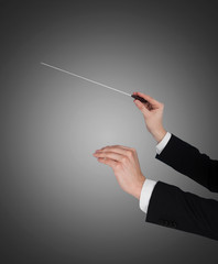 Closeup Of Music Conductor's Hands Holding Baton