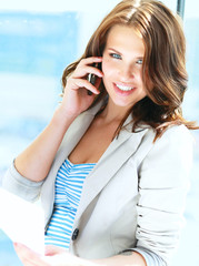 Portrait of young businesswoman talking on mobile phone on