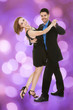 Loving Couple Dancing Against Purple Background