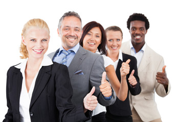 Business People Gesturing Thumbsup Over White Background