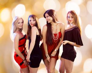 Gorgeous Women Dancing At Nightclub