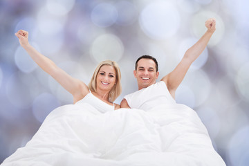 Successful Couple On Bed