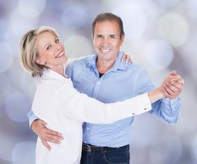 Portrait Of Affectionate Couple Dancing