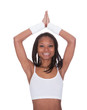 Sporty Woman Performing Yoga Against White Background
