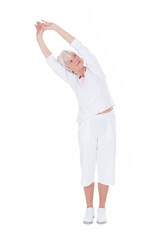 Senior Woman Doing Stretching Exercise Over White Background