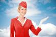 Leinwanddruck Bild - Charming Stewardess Dressed In Red Uniform Holding In Hand. Sky