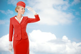 Charming Stewardess Dressed In Red Uniform. Sky With Clouds Back