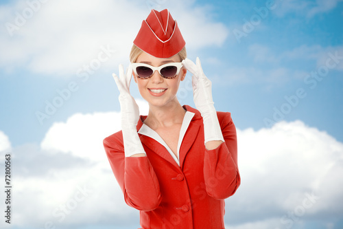 Charming Stewardess Dressed In Red Uniform And Vintage Sunglasse - 72800563