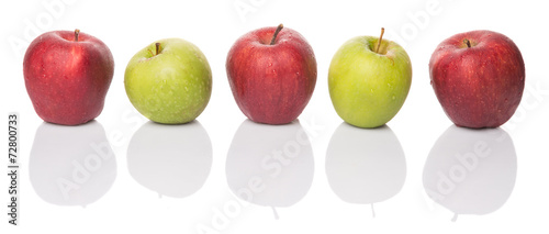 Red and green apple over white background