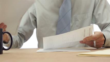 Secretary Looks Through Papers Desperately
