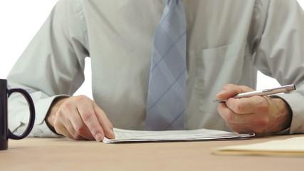Office Worker Checks Off Paper List