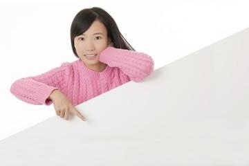 Beautiful Chinese woman holging a blank card