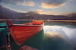 canvas print picture - wooden boat on a mooring mountain lake
