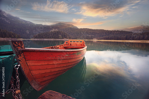 canvas print picture wooden boat on a mooring mountain lake