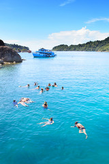 tourist snorkeling on blue clear water at koh chang island trat
