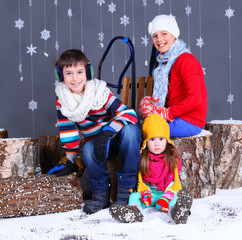 Winter Fashion. Adorable happy boy and girls.