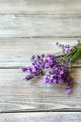 Bunch of  lavender flowers on old wooden table