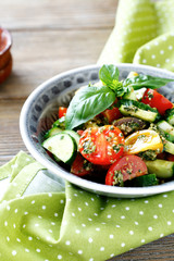 salad with tomato, cucumber and pesto
