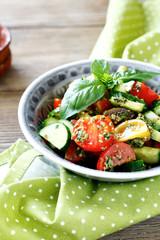 salad with tomato, cucumber and pesto