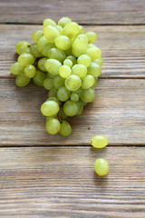 bunch green grapes on boards