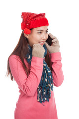 Asian girl with red christmas hat excited talk on mobile phone