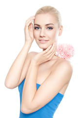 Beautiful young blond woman with pink flower