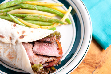 flank steak burrito on home made flatbread with garlic fried str
