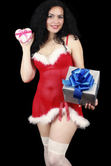 Christmas sensual brunette girl with gifts, sexy dressed