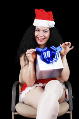 Christmas sensual brunette girl with gifts, isolated on black