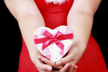 Christmas sensual girl with gifts isolated on black background