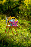 basket with linen outdoors poster