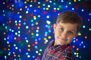 child and Christmas lights