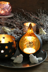 Composition with beautiful candlesticks, Christmas wreath and