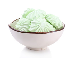 Mint color meringues in bowl isolated on white