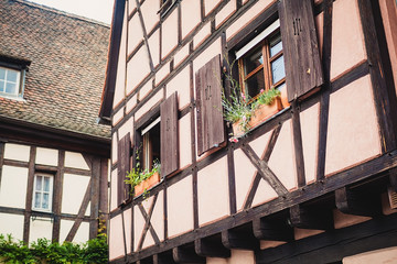 Old half timber (fachwerk) windows on house in Colmar, France.