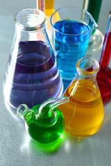 Different laboratory glassware with colorful liquid