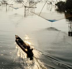 Fisherman Boat and Square Fish Net in Morning Sunrise at Songkla