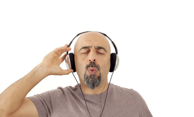 The man listening to the music and whistling
