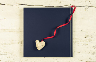 Heart and board for text message, vintage, toned image.