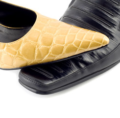 Black male shoe and yellow female shoe isolated on white